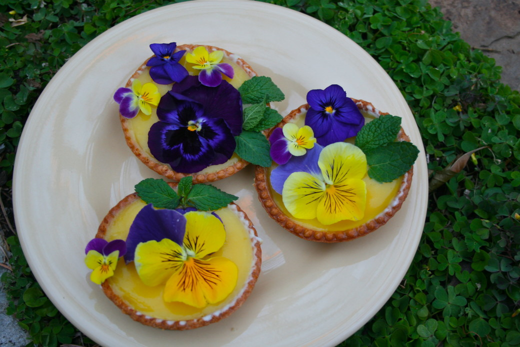 lemon tart garnished with edible flowers